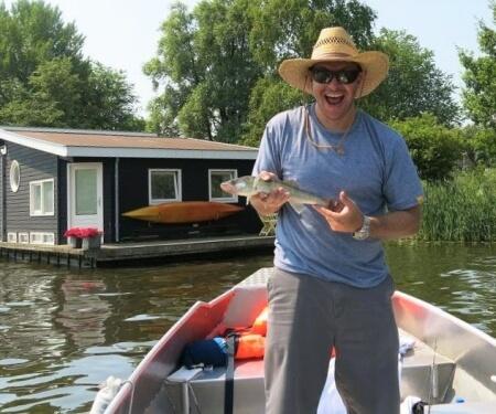 Fishing Amstel river Amsterdam